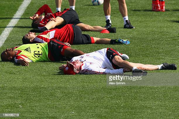 Head coach Jupp Heynckes stretches during a training session of Bayern Muenchen at the ASPIRE Academy for Sports Excellence on January 4 2012 in Doha...