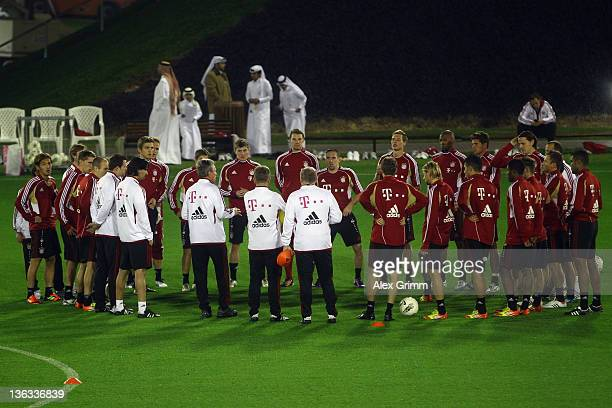 Head coach Jupp Heynckes talks to players during a training session of Bayern Muenchen at the ASPIRE Academy for Sports Excellence on January 2 2012...