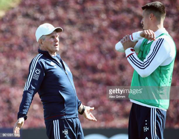 Head coach Jupp Heynckes talks to Sandro Wagner during a training session on day 3 of the FC Bayern Muenchen training camp at ASPIRE Academy for...