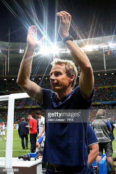 Head coach Jurgen Klinsmann of the United States applauds the fans after the 12 defeat in the 2014 FIFA World Cup Brazil Round of 16 match between...