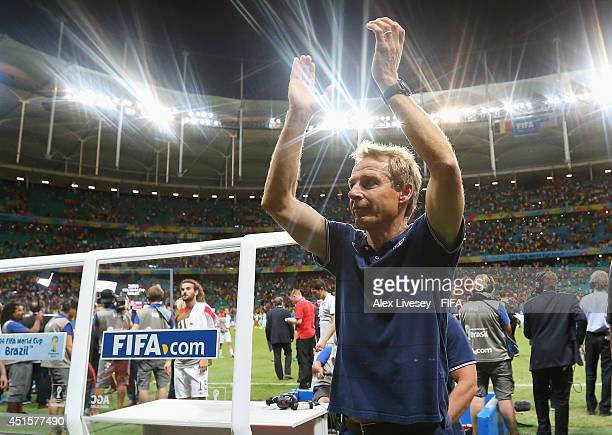 Head coach Jurgen Klinsmann of the United States applauds the fans after losing the 2014 FIFA World Cup Brazil Round of 16 match between Belgium and...