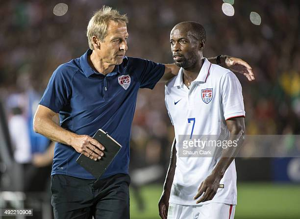 Head coach Jurgen Klinsmann of the United States comforts DaMarcus Beasley of the United States following the CONCACAF Cup between the United States...