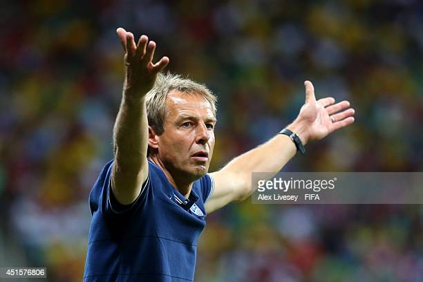 Head coach Jurgen Klinsmann of the United States gestures during the 2014 FIFA World Cup Brazil Round of 16 match between Belgium and USA at Arena...