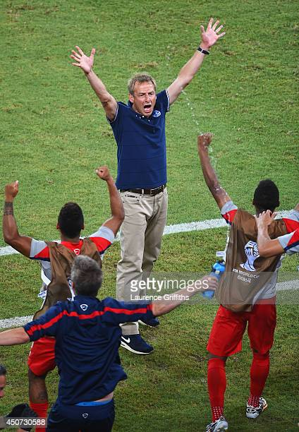 Head coach Jurgen Klinsmann of the United States reacts after defeating Ghana 21 during the 2014 FIFA World Cup Brazil Group G match between Ghana...
