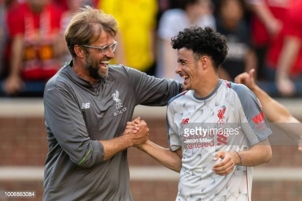 Head coach Jurgen Klopp celebrates with Curtis Jones after Liverpool defeated Manchester United during second half of the International Champions Cup...