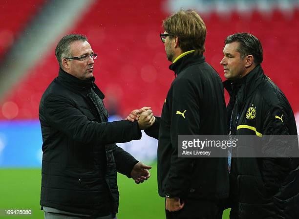 Head Coach Jurgen Klopp of Borussia Dortmund greets Manager Paul Lambert of Aston Villa during a Borussia Dortmund training session ahead of the UEFA...
