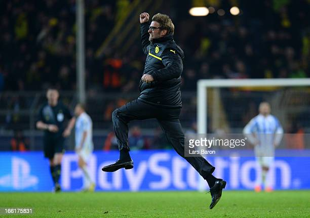 Head Coach Jurgen Klopp of Borussia Dortmund runs onto the pitch to celebrate victory at the final whistle during the UEFA Champions League...
