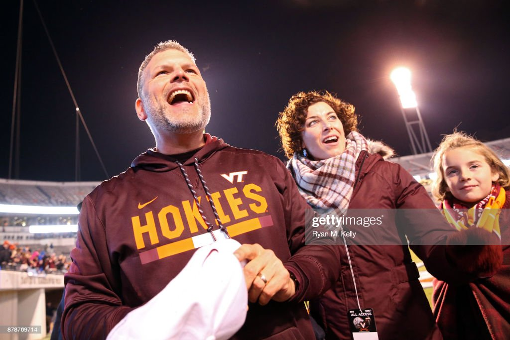 Head coach Justin Fuente of the Virginia Tech Hokies celebrates with his family after a game against the Virginia Cavaliers at Scott Stadium on November 24, 2017 in Charlottesville, Virginia. Virginia Tech defeated Virginia 10-0.