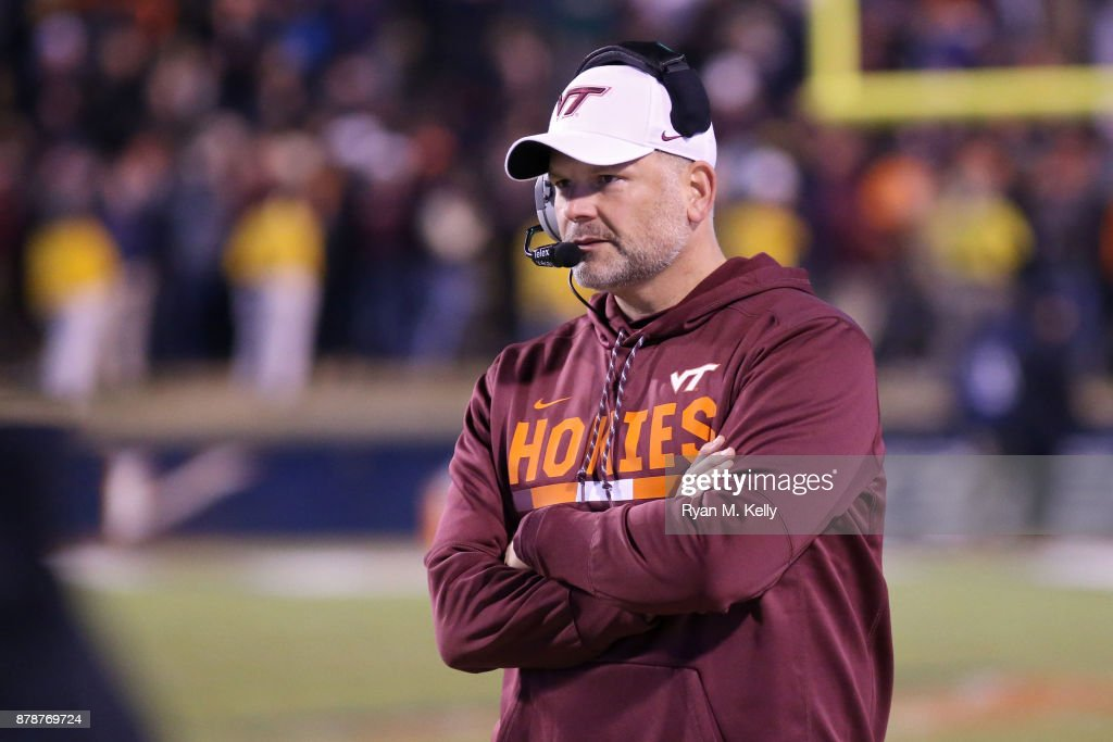 Head coach Justin Fuente of the Virginia Tech Hokies watches a play in the third quarter during a game against the Virginia Cavaliers at Scott Stadium on November 24, 2017 in Charlottesville, Virginia. Virginia Tech defeated Virginia 10-0.