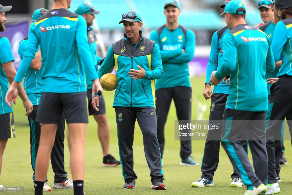 Head Coach Justin Langer of Australia speaks to his players during an Australia Net Session at The Kia Oval on June 12, 2018 in London, England.