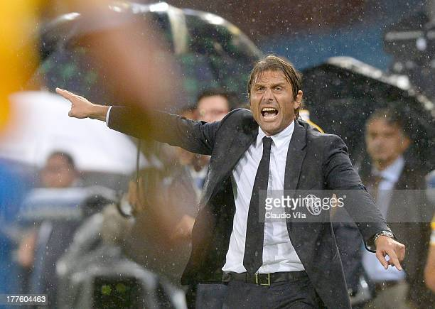 Head coach Juventus Antonio Conte reacts during the Serie A match between UC Sampdoria and Juventus at Stadio Luigi Ferraris on August 24 2013 in...
