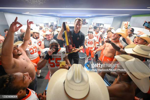 Head coach K. C. Keeler of the Sam Houston State Bearkats celebrates his victory over the South Dakota State Jackrabbits in the locker room during...