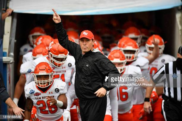 Head coach K. C. Keeler of the Sam Houston State Bearkats runs onto the field before the game against the South Dakota State Jackrabbits during the...