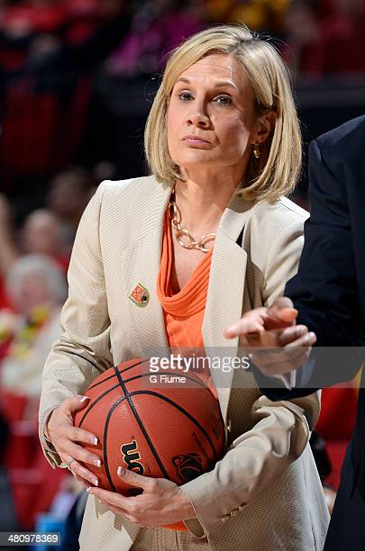 Head coach Karen Aston of the Texas Longhorns holds the basketball during a break in the game against the Maryland Terrapins during the Second Round...