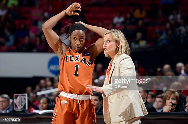 Head coach Karen Aston of the Texas Longhorns talks with Empress Davenport during the game against the Maryland Terrapins during the Second Round of...