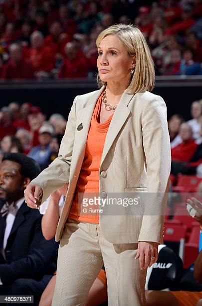 Head coach Karen Aston of the Texas Longhorns watches the game against the Maryland Terrapins during the Second Round of the NCAA women's basketball...