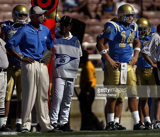 UCLA head coach Karl Dorrell left and Bruin quarterback Drew Olson look on during the final minutes of the game during their loss to Oklahoma State...