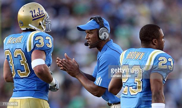 Head Coach Karl Dorrell of the UCLA Bruins encourages his players after a defensive stop against the Notre Dame Fighting Irish during their NCAA...