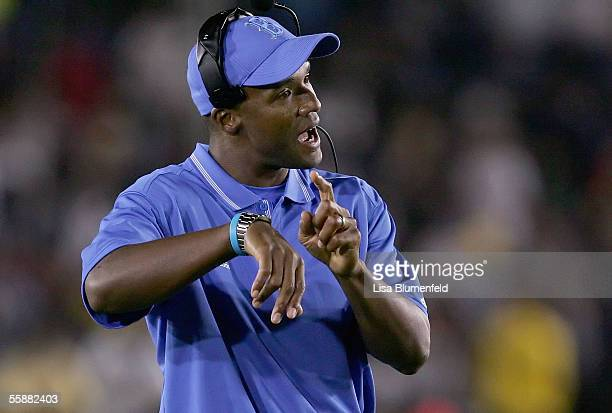 Head coach Karl Dorrell of the UCLA Bruins motions to the referees during a game against the University of California Golden Bears October 8 2005 at...