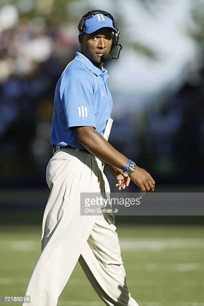 Head coach Karl Dorrell of the UCLA Bruins reacts to play while walking the sideline during the game against the Washington Huskies on September 23...