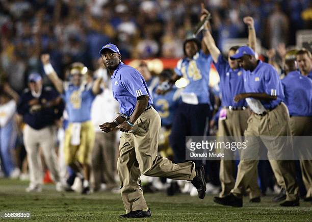 Head Coach Karl Dorrell of the UCLA Bruins runs out on the field as time expires during his teams' 2117 win over the Washington Huskies in their...