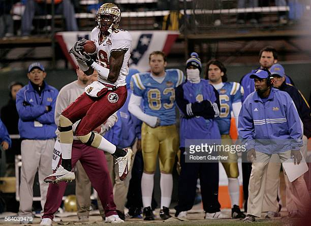 UCLA head coach Karl Dorrell right can only watch as Florida State receiver Greg Carr catches a pass for a big gain in the fourth quarter of the...