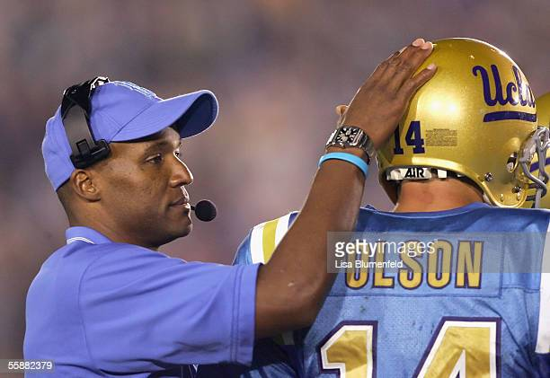 Head coach Karl Dorrell talks with quarterback Drew Olson of the UCLA Bruins during the fourth quarter against the University of California Golden...