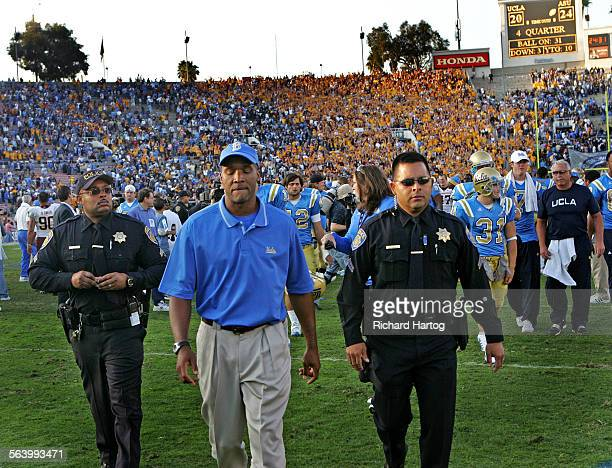 UCLA head coach Karl Dorrell walks off the field after his Bruins lost to ASU at the Rose Bowl in Pasadena Saturday November 10 2007