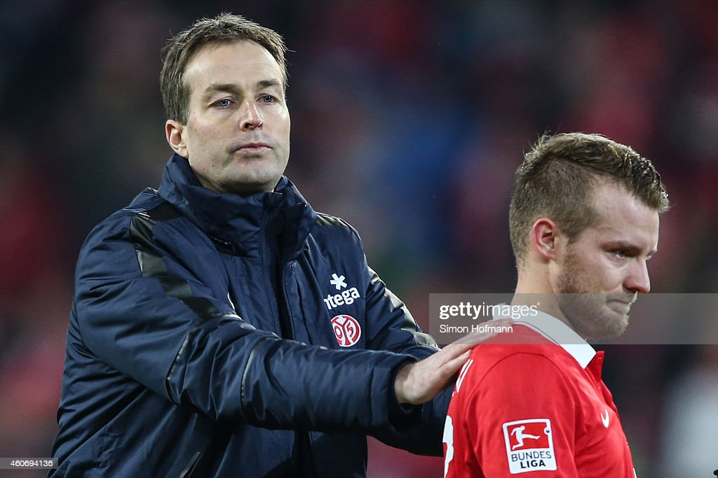 Head coach Kasper Hjulmand of Mainz and Daniel Brosinski look on after the Bundesliga match between 1. FSV Mainz 05 and FC Bayern Muenchen at Coface Arena on December 19, 2014 in Mainz, Germany.