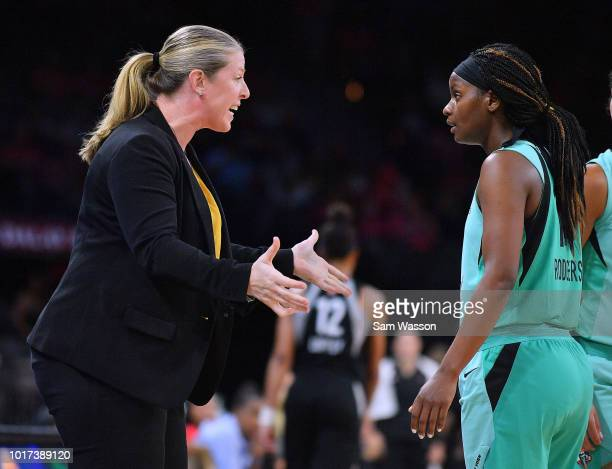 Head coach Katie Smith of the New York Liberty talks to Sugar Rodgers of the New York Liberty during a timeout of their game against the Las Vegas...