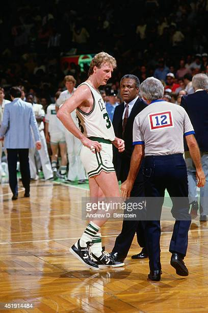 Head coach KC Jones and Larry Bird of the Boston Celtics speak with officials during a timeout in 1987 at the Boston Garden in Boston Massachusetts...