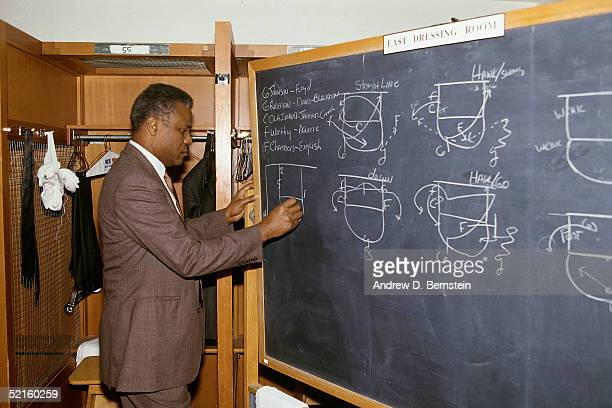 Head coach KC Jones of the Boston Celtics draws up plays on the blackboard prior to a NBA game at the Boston Garden in 1987 in Boston Massachusetts...