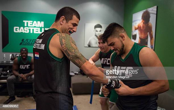 Head coach Kelvin Gastelum helps put Cesar Arzamendia's gloves on before facing Oliver Meza during the filming of The Ultimate Fighter Latin America...