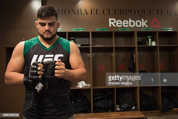 Head coach Kelvin Gastelum prepares the gloves for Cesar Arzamendia before facing Oliver Meza during the filming of The Ultimate Fighter Latin...