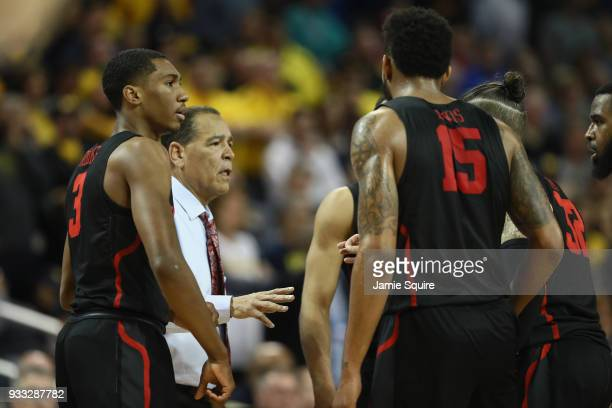 Head coach Kelvin Sampson of the Houston Cougars talks with the team as they take on the Michigan Wolverines in the second half during the second...