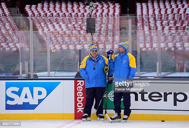 Head coach Ken Hitchcock left and assistant coach Mike Yeo of the St Louis Blues look on during practice for the 2017 Bridgestone NHL Winter Classic...