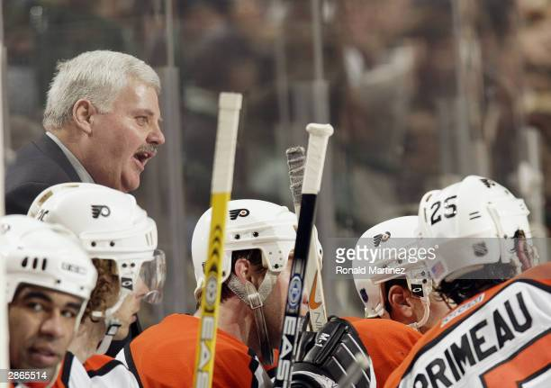 Head coach Ken Hitchcock of the Philadelphia Flyers talks to his players on the bench during the game against the Dallas Stars at the American...