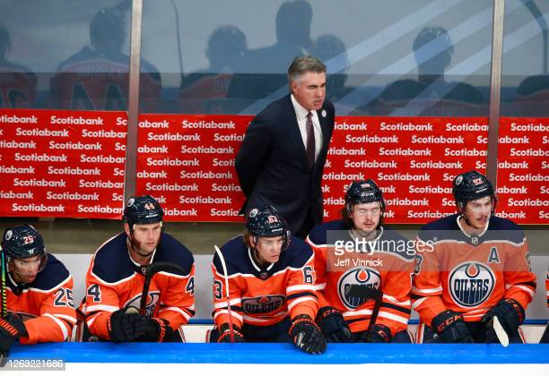 Head coach Ken Holland of the Edmonton Oilers looks on from the bench in the second period against the Chicago Blackhawks in Game One of the Western...