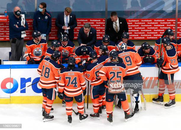 Head coach Ken Holland of the Edmonton Oilers talks to his players late in the third period against the Chicago Blackhawks during Game One of the...