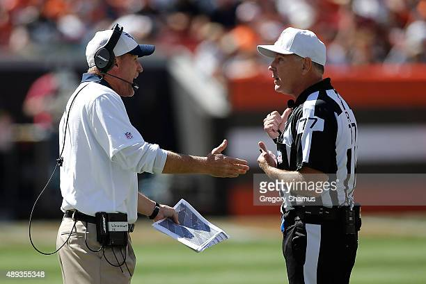 Head coach Ken Whisenhunt argues with referee Terry McAulay at FirstEnergy Stadium on September 20 2015 in Cleveland Ohio Cleveland won the game 2814