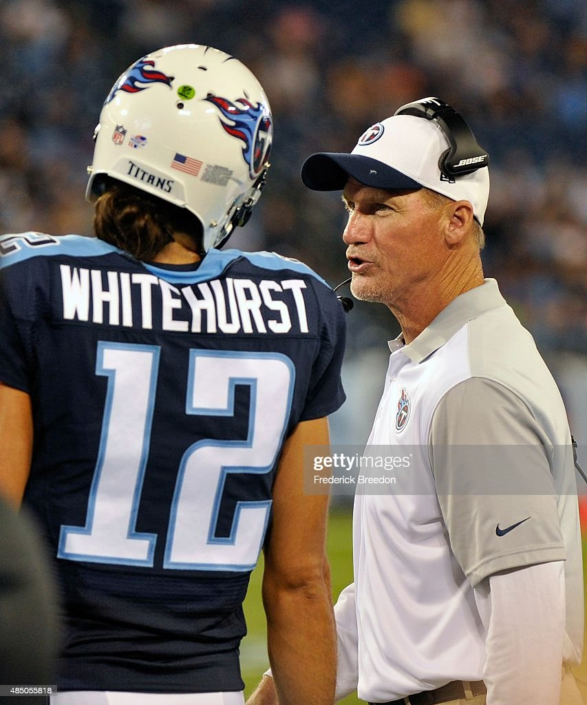 Head coach Ken Whisenhunt of the Tennessee Titans speaks to quarterback Charlie Whitehurst #12 during the second half of a pre-season game against the St. Louis Rams at LP Field on August 23, 2015 in Nashville, Tennessee.