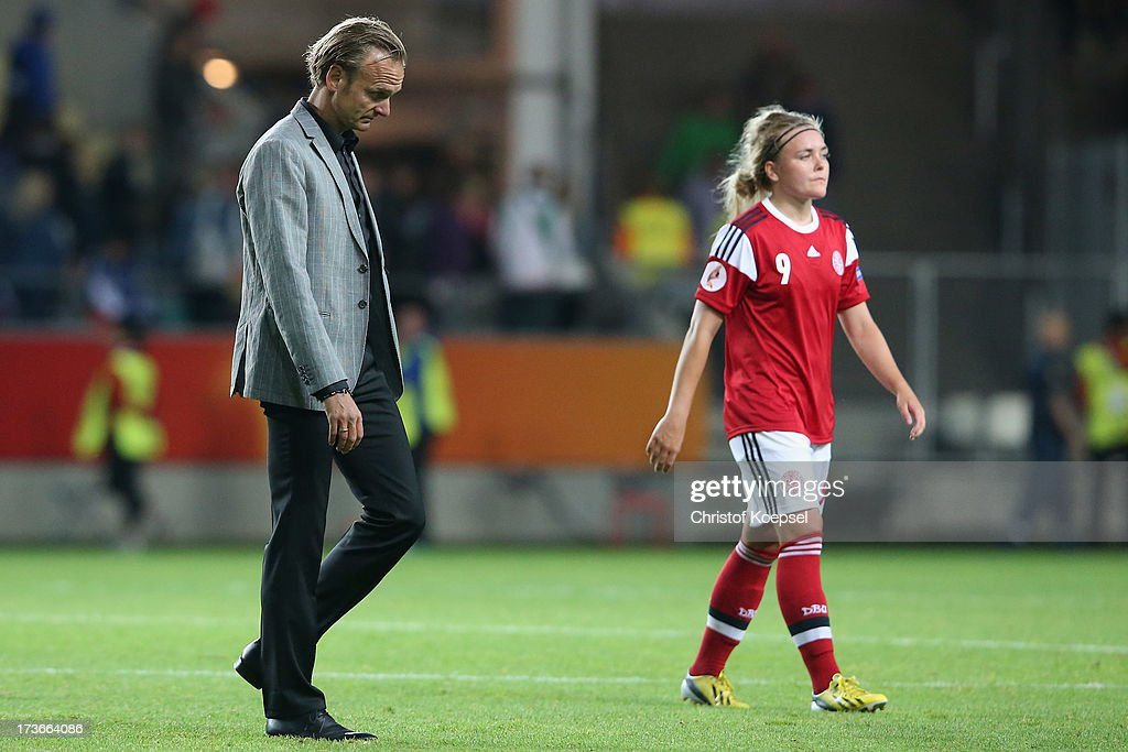Head coach Kenneth Heiner-Moeller and Nanna Christiansen of Denmark look dejected after the UEFA Women's EURO 2013 Group A match between Denmark and Finland at Gamla Ullevi Stadium on July 16, 2013 in Gothenburg, Sweden. The match between Denmark and Finland ended 1-1.