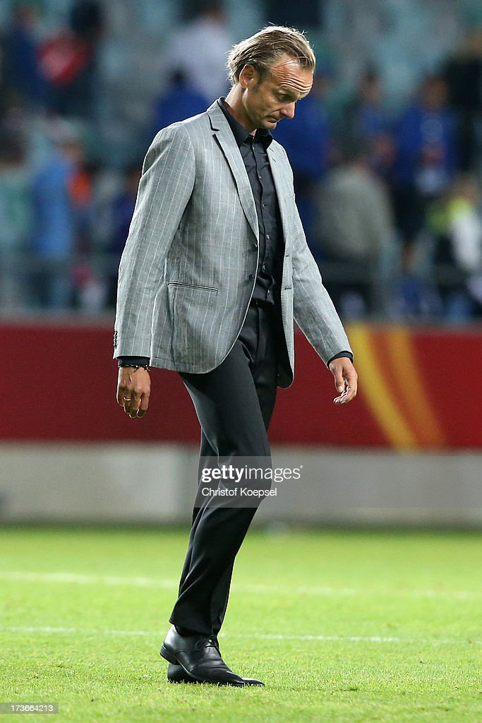 Head coach Kenneth Heiner-Moeller of Denmark looks dejected after the UEFA Women's EURO 2013 Group A match between Denmark and Finland at Gamla Ullevi Stadium on July 16, 2013 in Gothenburg, Sweden. The match between Denmark and Finland ended 1-1.