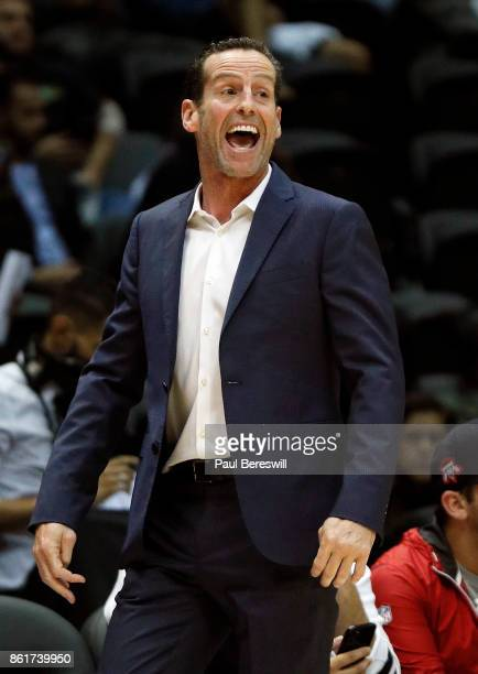 Head coach Kenny Atkinson of the Brooklyn Nets coaches during a preseason NBA basketball game against the Philadelphia 76ers on October 11 2017 at...