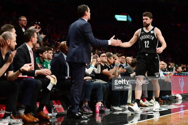 Head coach Kenny Atkinson slaps hands with Joe Harris of the Brooklyn Nets during the fourth quarter of the game against the Boston Celtics at...