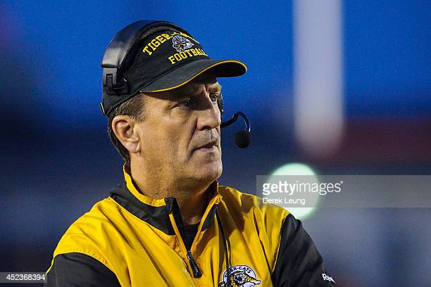 Head coach Kent Austin of the Hamilton Tiger-Cats watches play against the Calgary Stampeders during a CFL game at McMahon Stadium on July 18, 2014...