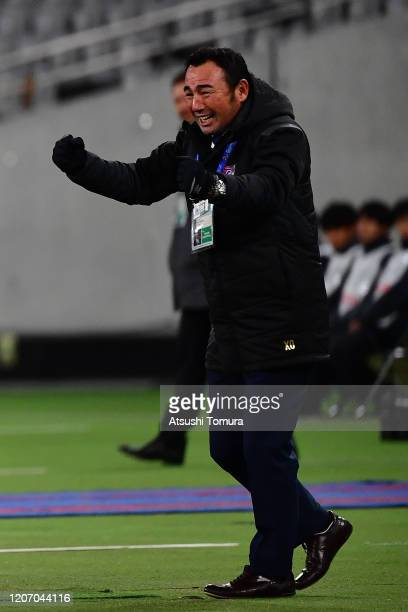 Head coach Kenta Hasegawa celebrates after Leandro of FC Tokyo score a goal during the AFC Champions League Group F match between FC Tokyo and Perth...
