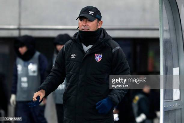 Head coach Kenta Hasegawa of FC Tokyo looks on prior to the AFC Champions League play off between FC Tokyo and Ceres-Negros at Tokyo Stadium on...