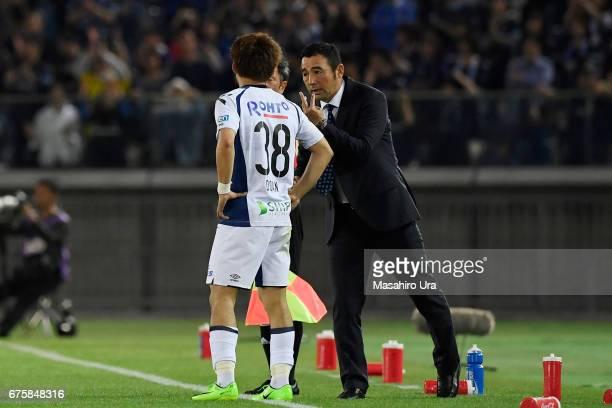 Head coach Kenta Hasegawa of Gamba Osaka gives instruction to Ritsu Doan during the JLeague J1 match between Yokohama FMarinos and Gamba Osaka at...