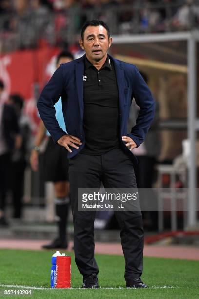 Head coach Kenta Hasegawa of Gamba Osaka looks on during the J.League J1 match between Kashima Antlers and Gamba Osaka at Kashima Soccer Stadium on...